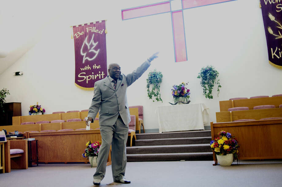 Anthony Revis, apostle and senior pastor at Faith Ministries Church, gives his sermon on Sunday during the church's 25th anniversary morning service. Photo: NICK KING | Nking@mdn.net