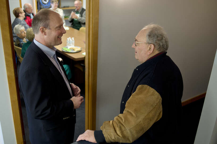 U.S. Rep. John Moolenaar, left, talks with Midland County Commissioner Al Kloha during Moolenaar's open house for his new office on the corner of Main and McDonald streets in downtown Midland. Photo: Brittney Lohmiller