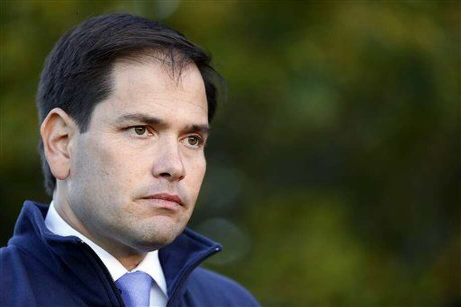 Republican presidential candidate Sen. Marco Rubio, R-Fla.,listens to a question during a house party campaign stop in Bedford, N.H. Voters are beginning to learn about Rubio but what they're not learning, however, is who is paying to promote his candidacy. Photo: Jim Cole | AP Photo