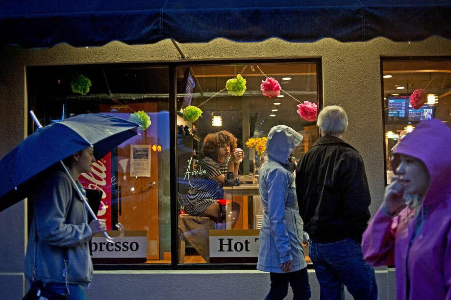 Northwood freshman Amelia Monsalvo, 18, poses in the window of Journey's Coffee House during Mannequin Night last night. Photo: Erin Kirkland | Midland Daily News