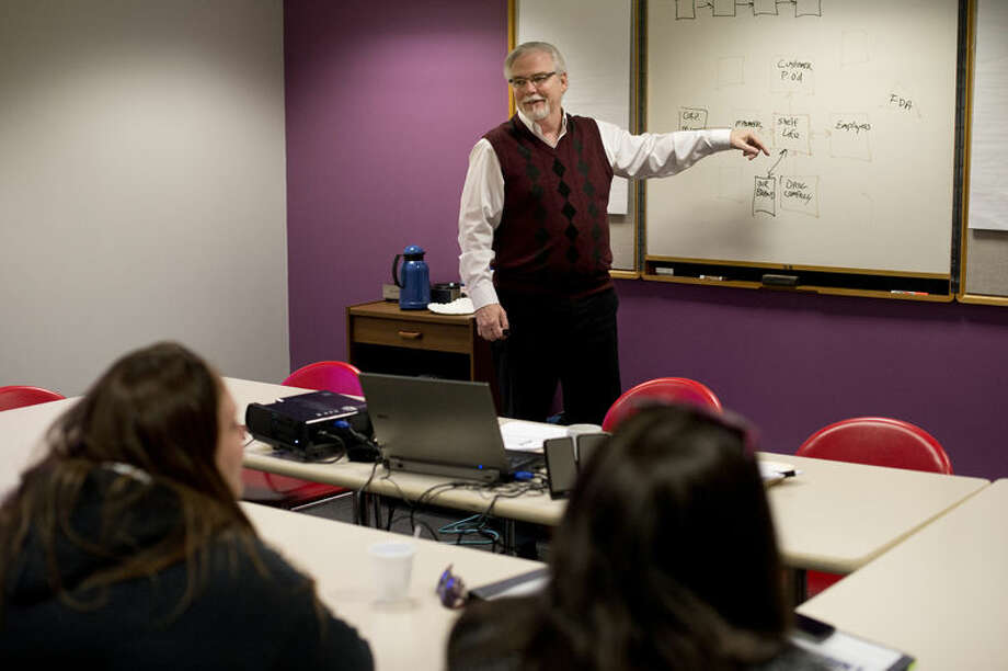 Tim Adams, Pivot Point Academy director, teaches a class. Pivot Point is a program of the Ten16 Recovery Network and strives to help people in early recovery get back into the workforce. Photo: Neil Blake/Midland Daily News