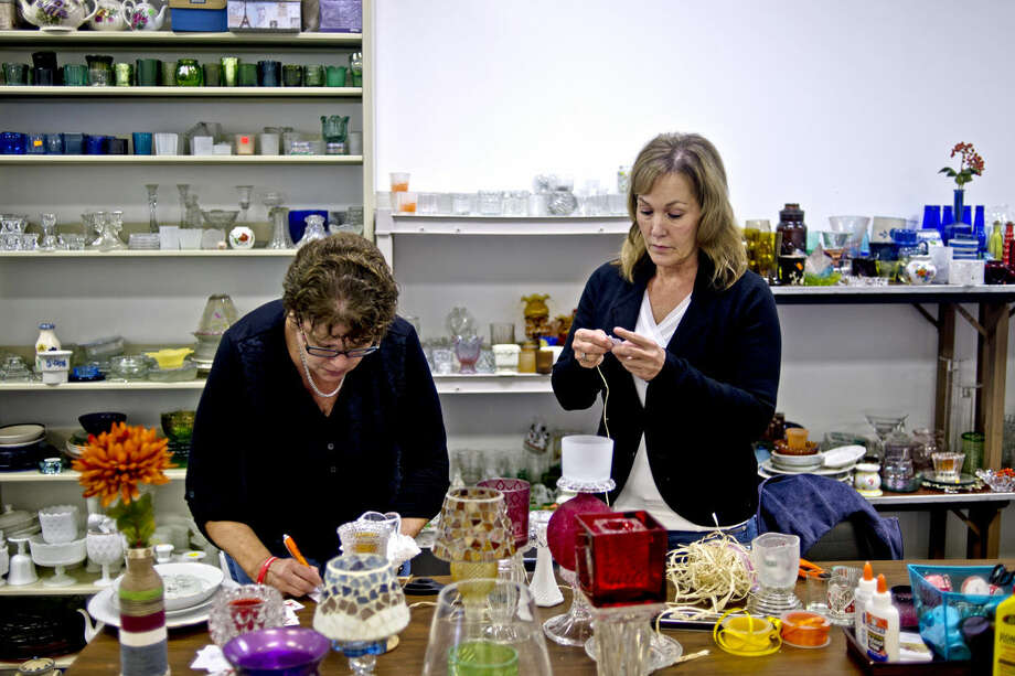 For a Brighter Tomorrow co-founders Jackie Maxwell, left, and Mary Knowlton, right, put price tags on glassware. The nonprofit sells the glassware in order to help those struggling with addiction by assisting with court orders, drug testing, sober housing and more. Photo: Erin Kirkland    Midland Daily News