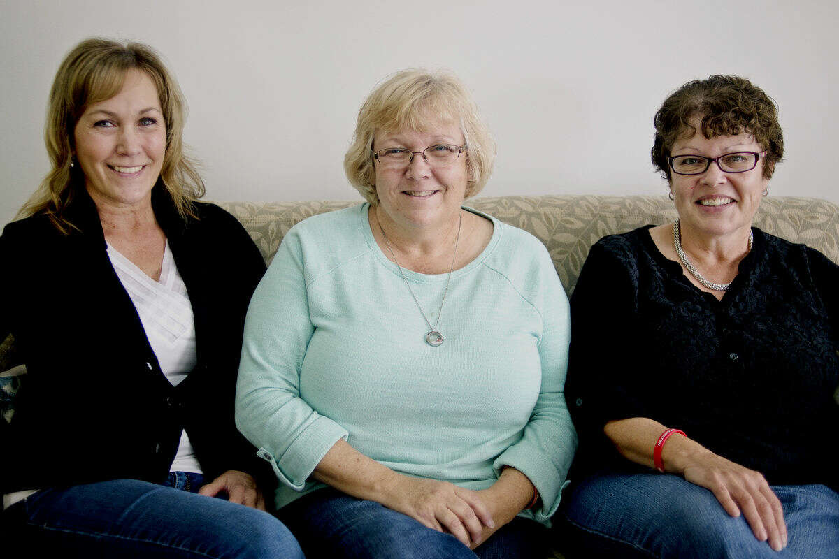 For a Brighter Tomorrow co-founders Mary Knowlton, left, Lori Wood, center, and Jackie Maxwell pose for a portrait on Friday.