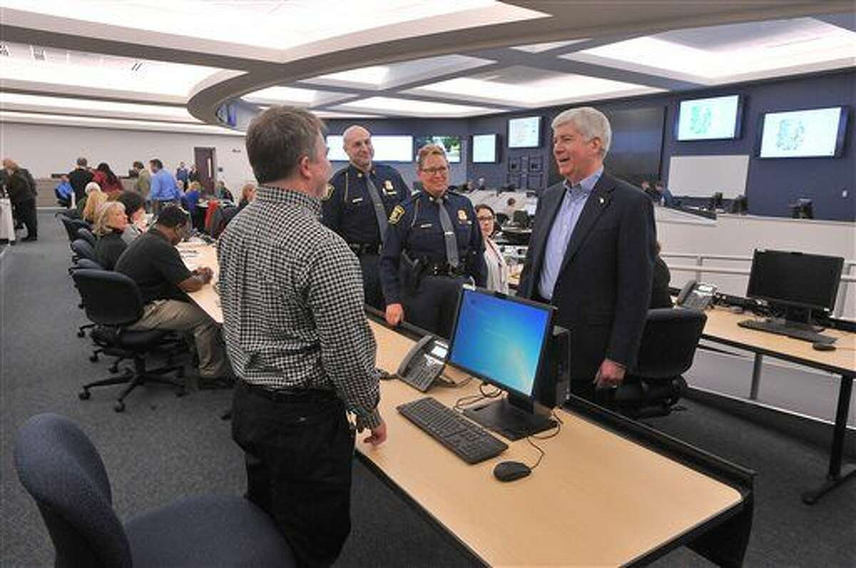 Michigan Gov. Rick Snyder visits the new state Emergency Management Center in Dimondale, Mich., Monday Feb. 22, 2016. (Dale G. Young/Detroit News via AP) DETROIT FREE PRESS OUT; HUFFINGTON POST OUT; MANDATORY CREDIT