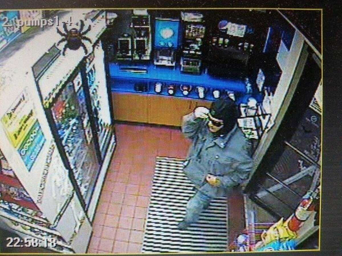 This suspect entered the gas station at 10:58 p.m. and demanded money and cigarettes.