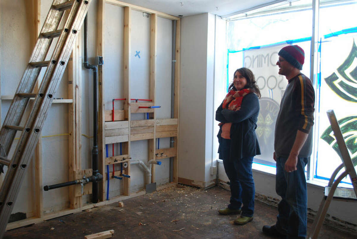 Amy Shindorf, left, and Brad Bellinger stand inside a 100-year-old building in downtown Clare. They are remodeling the building and will open Four Leaf Brewing, a craft brew pub. Four Leaf Brewing, named for the lucky four-leaf clover in the Irish tradition, will offer 12 craft brews on tap, including six regulars and six seasonal and experimental beers.