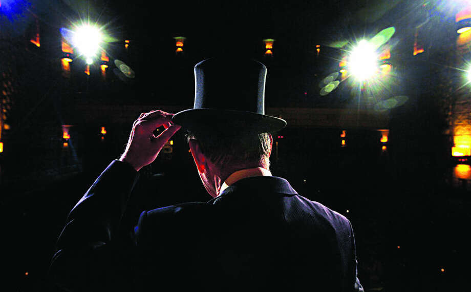 "THEOPHIL SYSLO | For the Daily News Gene Anderson, producer & director of ""The Vaudeville Show,"" adjust his top hat while on stage during a rehearsal of ""The Vaudeville Show"" at The State Theatre in Bay City on October 2, 2015. Photo: Theophil Syslo"