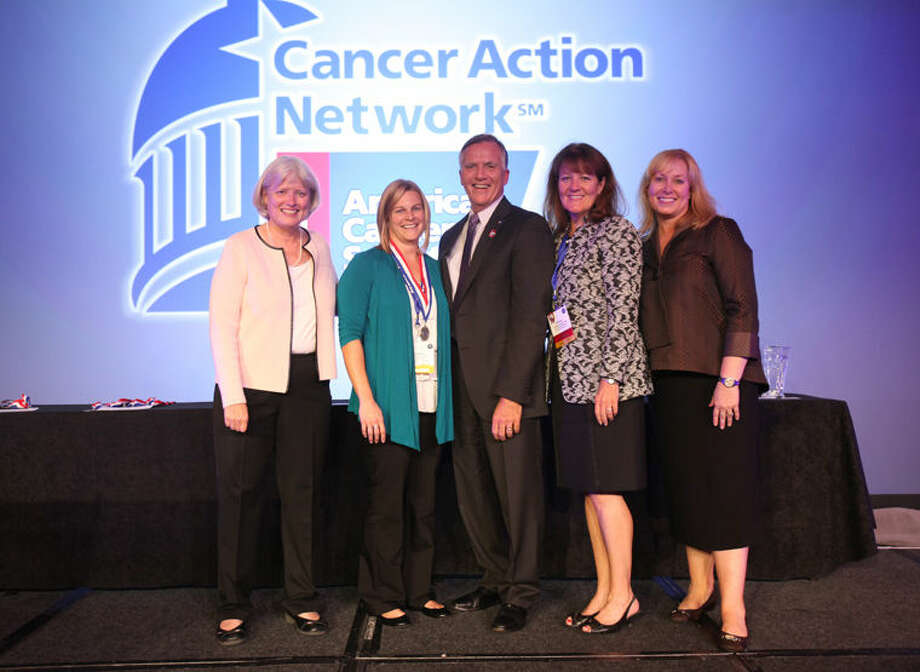 Freeland resident Jennifer Varner, second from the left, accepts the ACT Lead of the Year award from the American Cancer Society Cancer Action Network at its annual Leadership Summit and Lobby Day in Washington, D.C. From left are: Molly Daniels, chief advocacy officer for ACS CAN; Varner; Gary Reedy, CEO of the American Cancer Society; Dr. Christy Russell, chair of the ACS CAN board; Kelly Headrick, vice president of field advocacy operations for ACS CAN Photo: Photo Provided