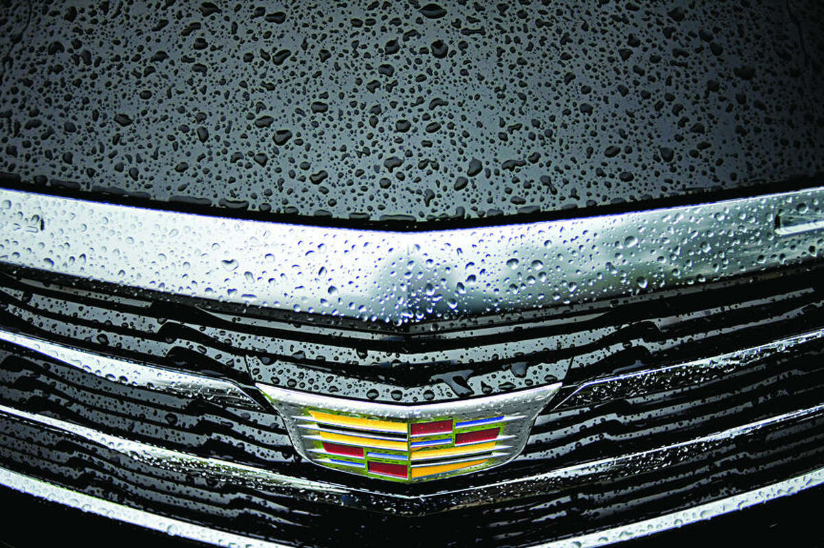 NICK KING | nking@mdn.net Rain drops bead on the hood and grille of a Cadillac 2016 ATS Sedan 2.0T AWD during the Northwood University International Auto Show on Saturday on the Northwood campus.