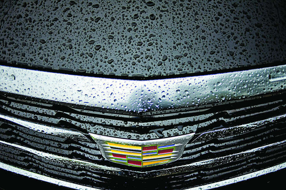 NICK KING | nking@mdn.net Rain drops bead on the hood and grille of a Cadillac 2016 ATS Sedan 2.0T AWD during the Northwood University International Auto Show on Saturday on the Northwood campus. Photo: Nick King/Midland Daily News