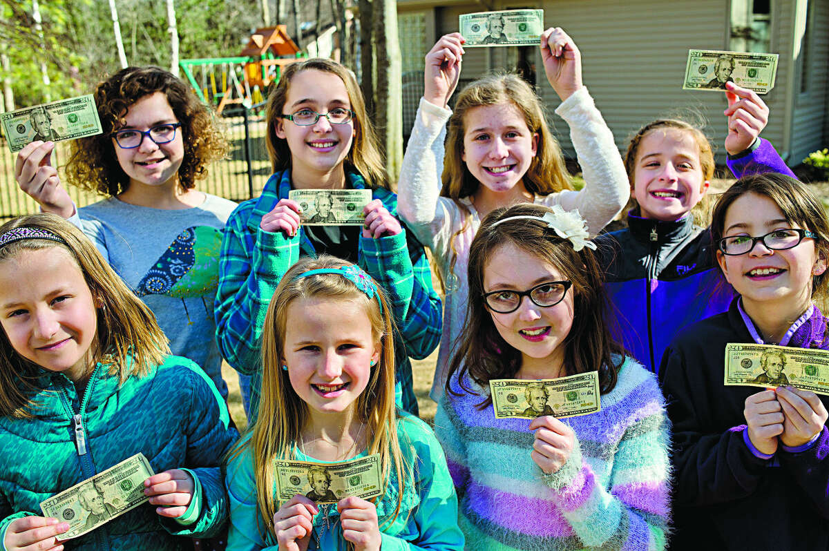 NICK KING | nking@mdn.net Front row, from left, Nine-year-olds Ashlyn Elford, Jade Remacle, Brooke Rubenacker and Abby Wilson; back row, from left, Ally Wilson, 11, Moira Blanchard, 12, Molly Birch, 11, Sydney Birch, 9, are the majority of the members of the Jackson Girls Club, a local organization that derives from the face of the $20 bill, Andrew Jackson, and denotes the amount each girl donates during the meetings.