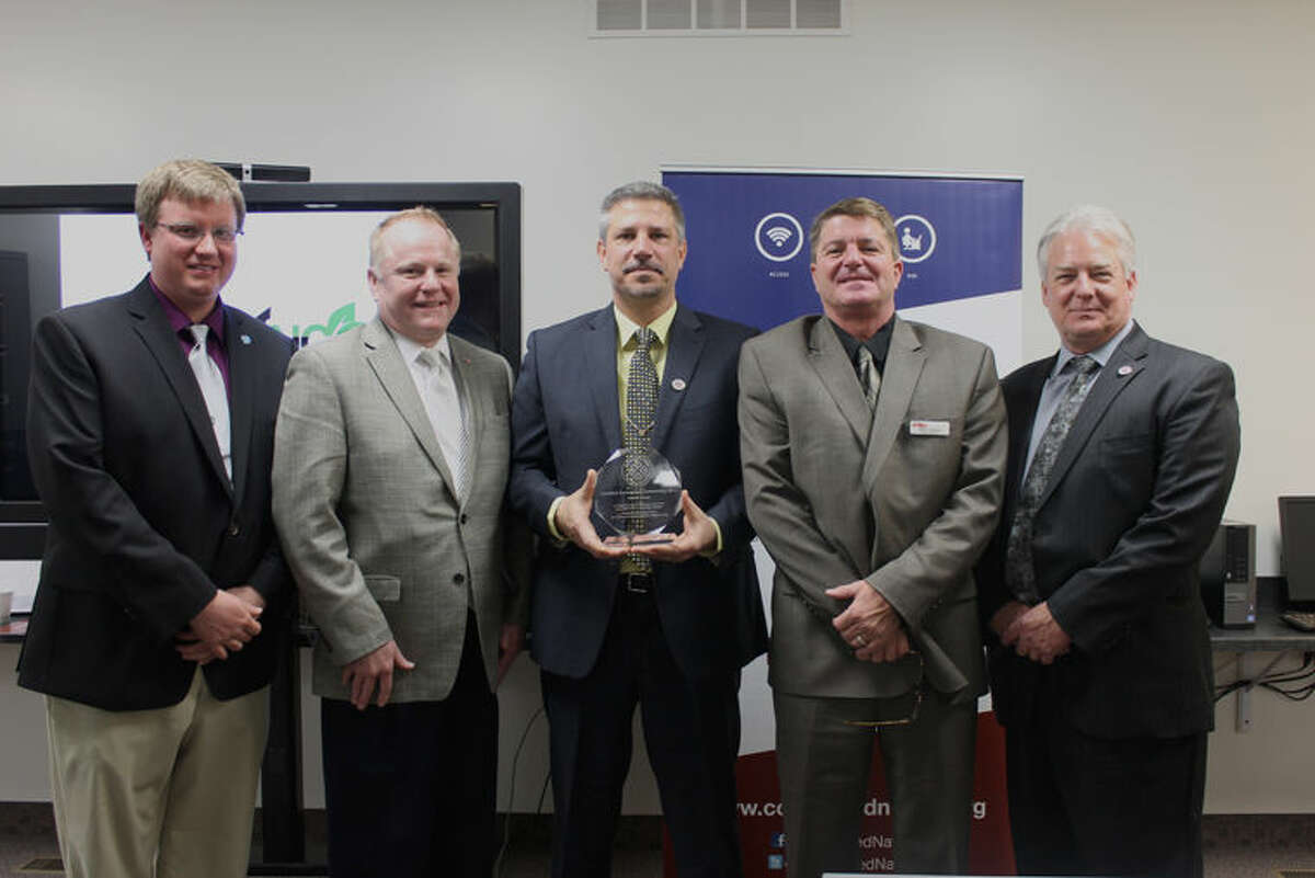 Representatives from Gladwin County receive the Certified Connected Community Award at Michigan Works!, 110 Buckeye St., Gladwin. From left are Eric Frederick, Scott Govitz, Bob Balzer, Mark Berdan, and Tom Stephenson.