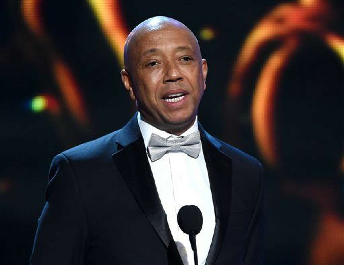 Feb. 6, 2015, file photo, Russell Simmons. Thousands of customers of prepaid debit cards backed by hip-hop mogul Simmons remain without access to their money more than a week after technical problems first began plaguing the cards. (Photo by Chris Pizzello/Invision/AP, File)