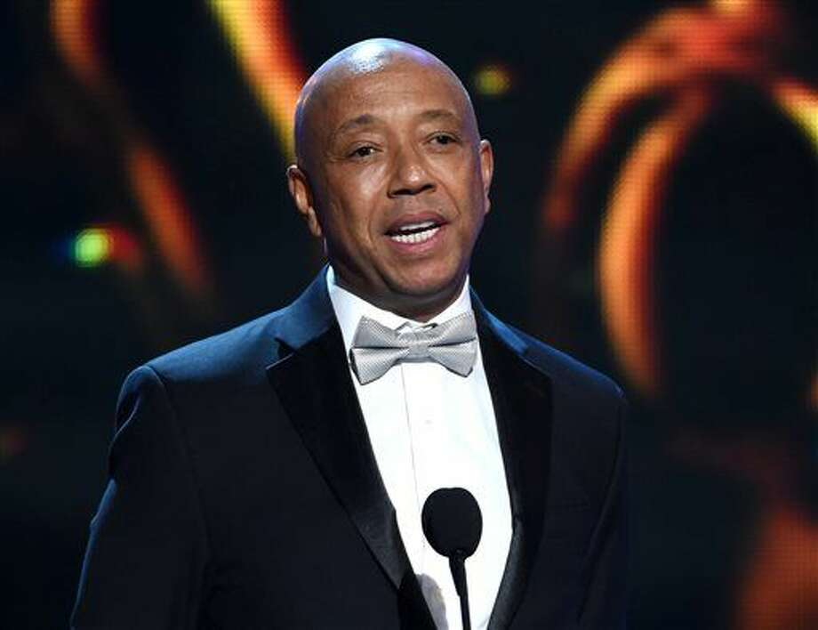 Feb. 6, 2015, file photo, Russell Simmons. Thousands of customers of prepaid debit cards backed by hip-hop mogul Simmons remain without access to their money more than a week after technical problems first began plaguing the cards. (Photo by Chris Pizzello/Invision/AP, File) Photo: Chris Pizzello