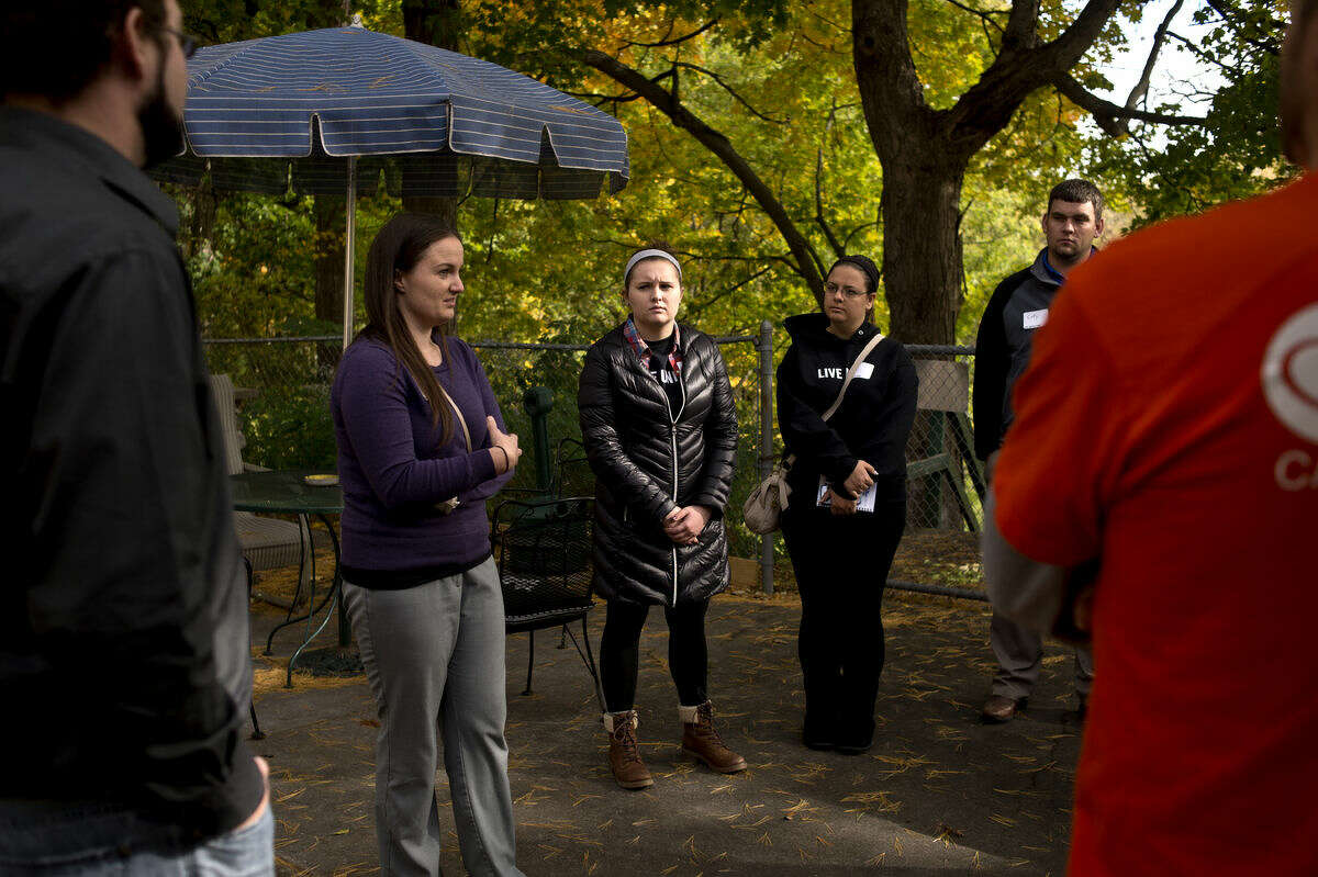 From left, Shelterhouse sexual assault services coordinator Audra Johnson talks to Young Leaders Helena Hill, Laura Rhodes and Coty Gould during a tour for Young Leaders United. The tour featured places such as Big Brothers, Big Sisters, ARC of Midland and Shelterhouse in an effort to illustrate places that connect with United Way's community goals.