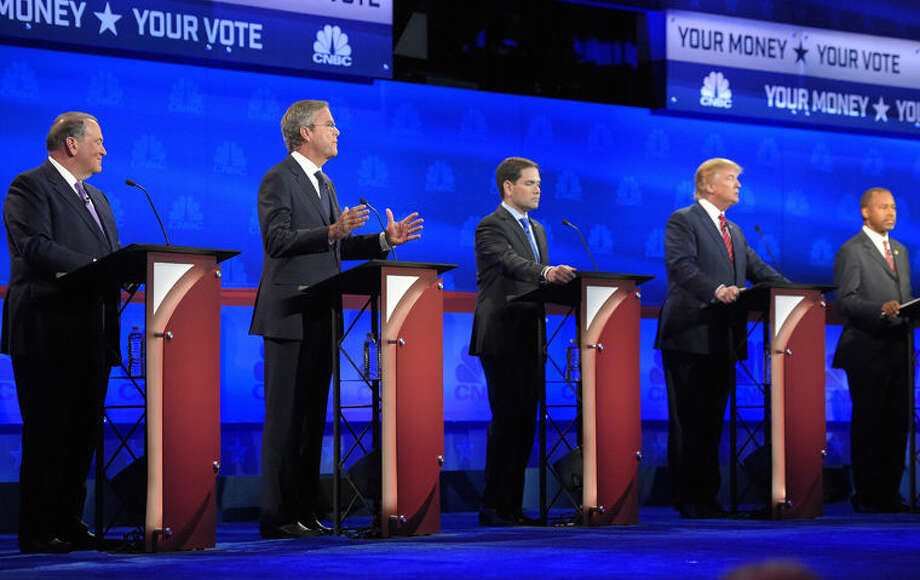 Jeb Bush, second from left, is flanked by Mike Huckabee, left, Marco Rubio, center, Donald Trump, second from right, and Ben Carson during the CNBC Republican presidential debate at the University of Colorado, Wednesday, Oct. 28, 2015, in Boulder, Colo. (AP Photo/Mark J. Terrill) Photo: Mark J. Terrill