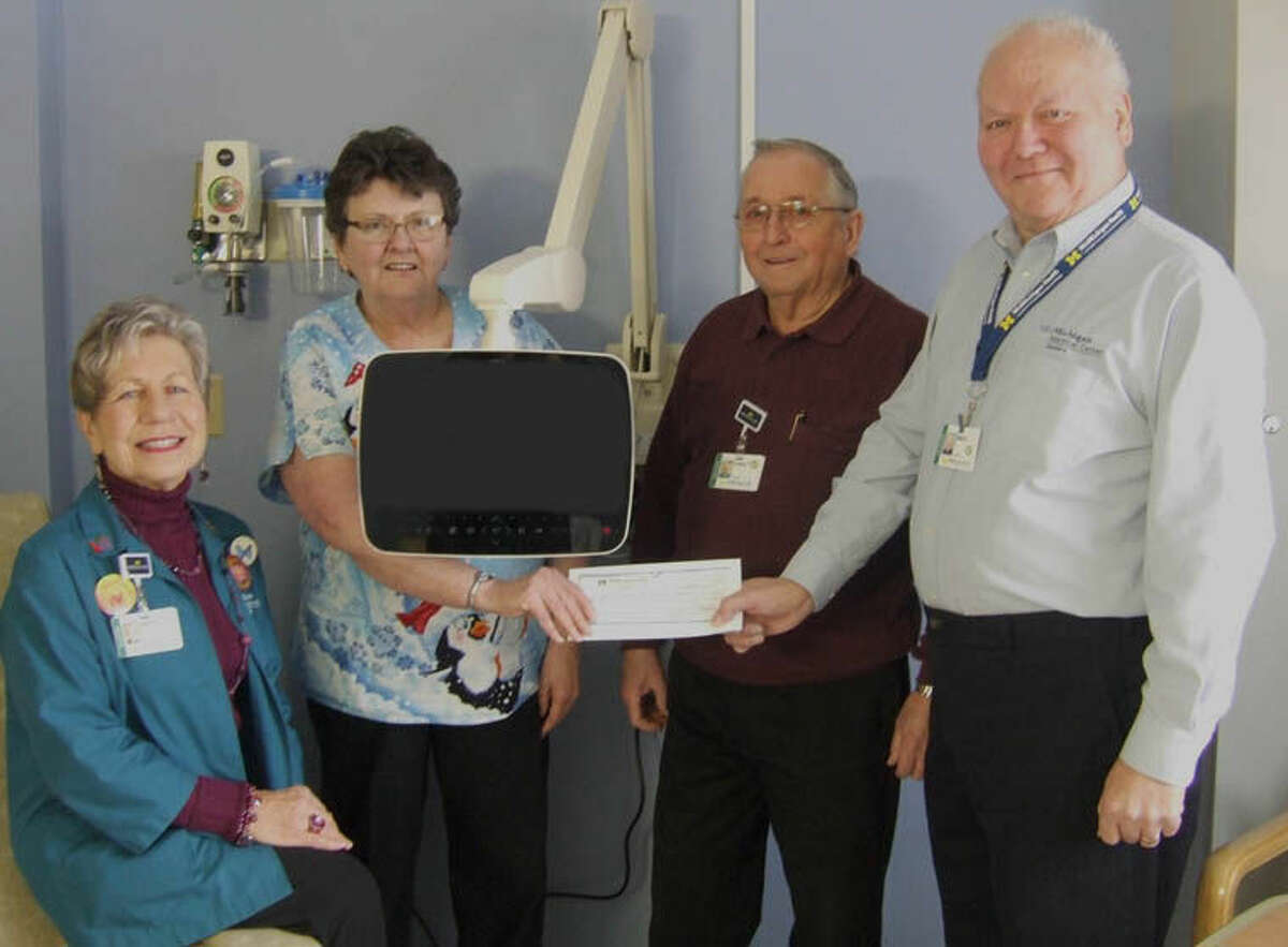 The volunteers of MidMichigan Medical Center-Gladwin recently presented a check in the amount of $1,763.14 for the purchase of two personalized TVs for the Infusion Clinic.