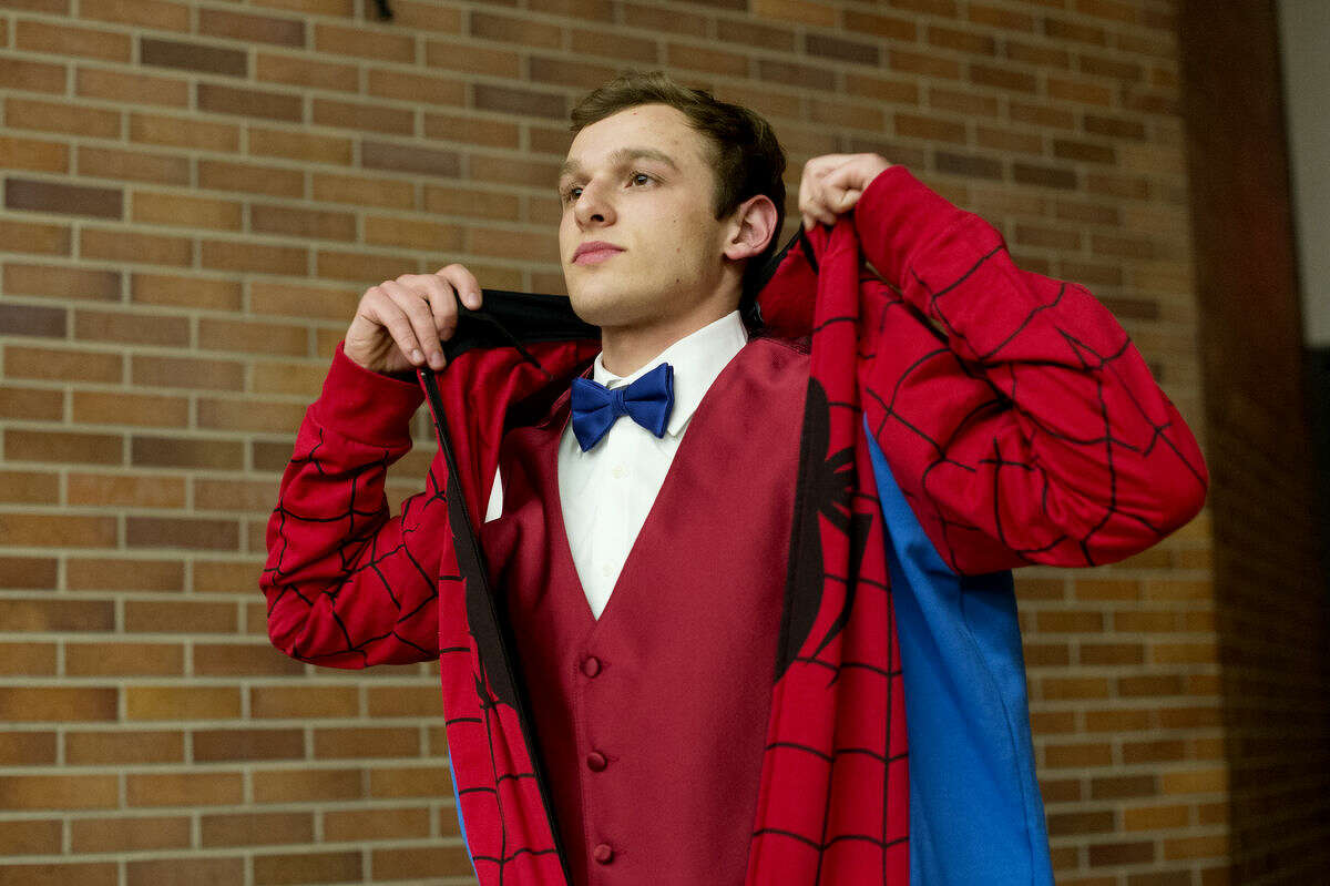 H.H. Dow High School senior Josh Pasek throws on a Spider-Man outift during a rehearsal for Ren Fair, an annual show benefiting the high school drama department. The show, at the Midland Center for the Arts at 7 p.m. on Saturday, has been performed since 1969. Tickets are $15 for adults (18-65) and $10 for students and seniors.