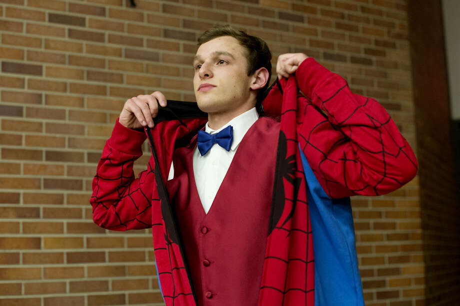 H.H. Dow High School senior Josh Pasek throws on a Spider-Man outift during a rehearsal for Ren Fair, an annual show benefiting the high school drama department. The show, at the Midland Center for the Arts at 7 p.m. on Saturday, has been performed since 1969. Tickets are $15 for adults (18-65) and $10 for students and seniors. Photo: NEIL BLAKE | Nblake@mdn.net