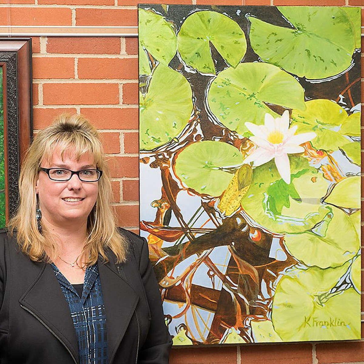 """Karen Franklin of Midland won the Best of Show award for her piece, an acrylic painting titled """"Lily and Light."""""""