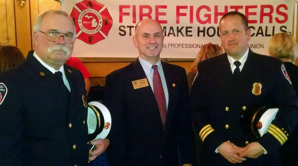 Pictured, from left, are Midland City Fire Chief Chris Coughlin, state Rep. Gary Glenn, R-Midland, and Midland City Fire Marshal Josh Mosher.