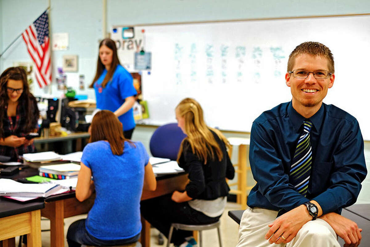 Ben Cooper, a teacher at Valley Lutheran High School in Saginaw, poses for a photo in his classroom.