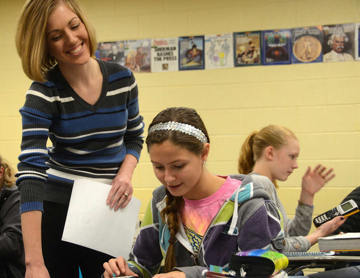 Amy Cooper, Ben Cooper's wife, talks with a student at Valley Luthern, where she also teaches. Both were recently awarded by the Lutheran Education Association.