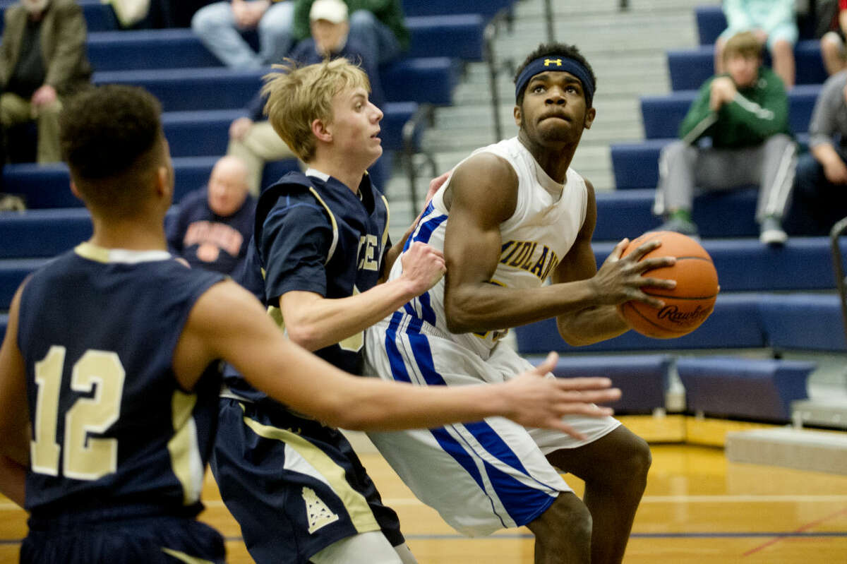 Midland High's Virgil Walker prepares to put up a shot during Friday's district final against Mount Pleasant at Saginaw Heritage High School.