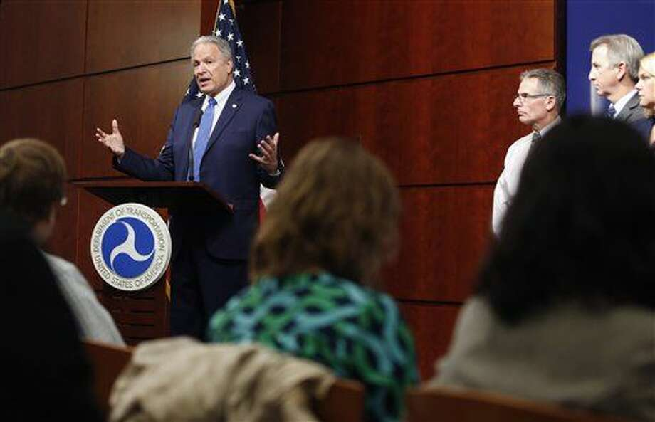 National Highway Traffic Safety Administration (NHTSA) Administrator Mark Rosekind, left, answers questions from the media after a public meeting to update safety risks involving Takata airbags Thursday at NHTSA headquarters in Washington. Photo: Alex Brandon | AP Photo