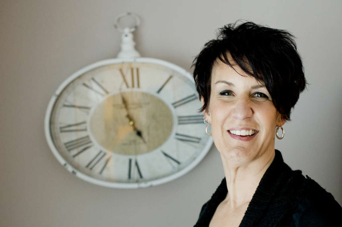 Terri Forster of Midland collects clocks. Forster counted over 50 on just the main floor of her home.