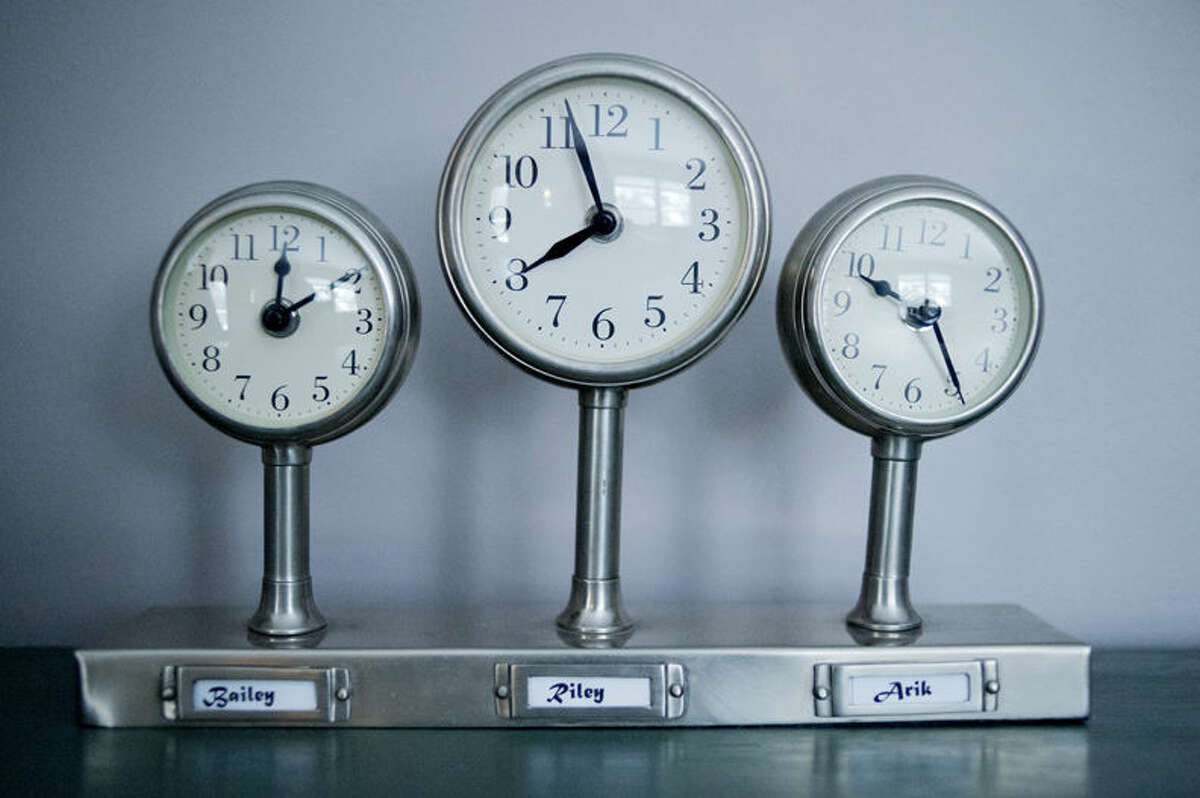 These clocks display the times that Terri Forster's children were born.