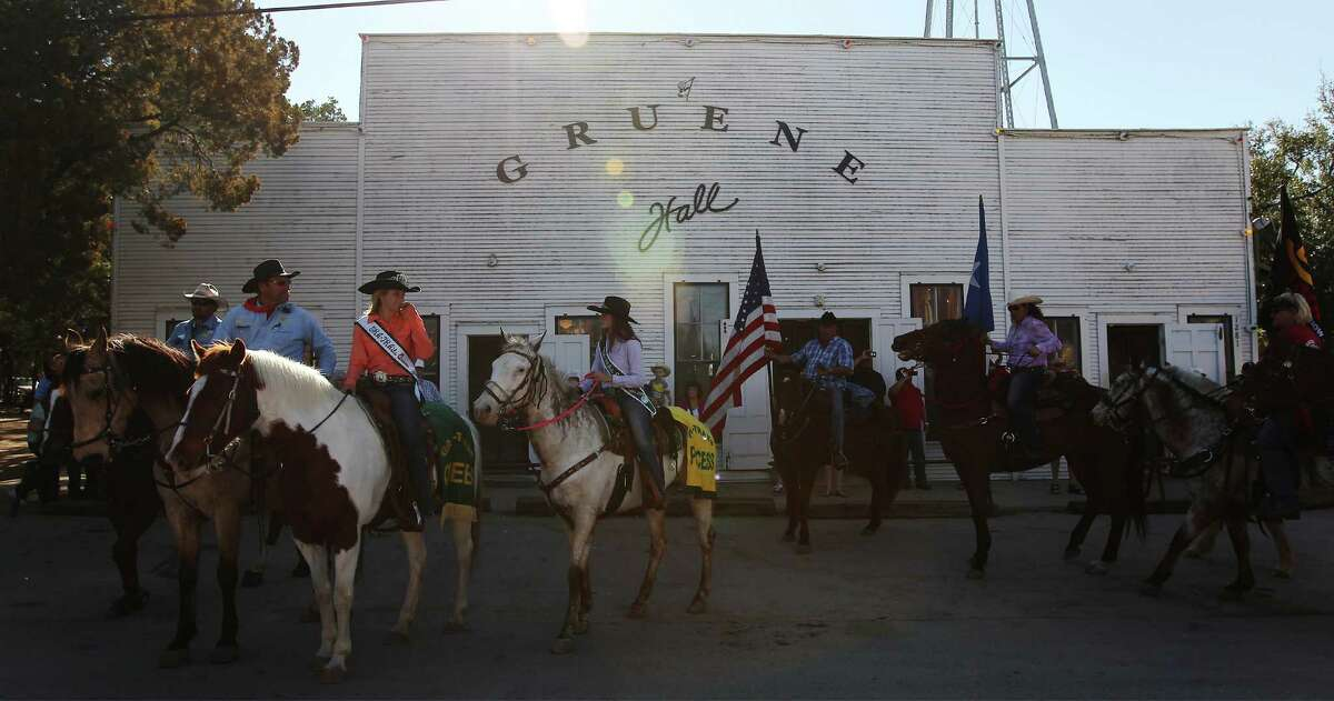 Members of the Greater Randolph Area Trail Ride group make a stop in front of Gruene Hall in Gruene, Texas while they make their way down to San Antonio for the 2015 Stock Show and Rodeo on Tuesday, Feb. 10, 2015. About 68 people rode horseback from Kyle, Texas and will trek about 90 miles to San Antonio. This year marks the 20th anniversary of the ride. (Kin Man Hui/San Antonio Express-News)
