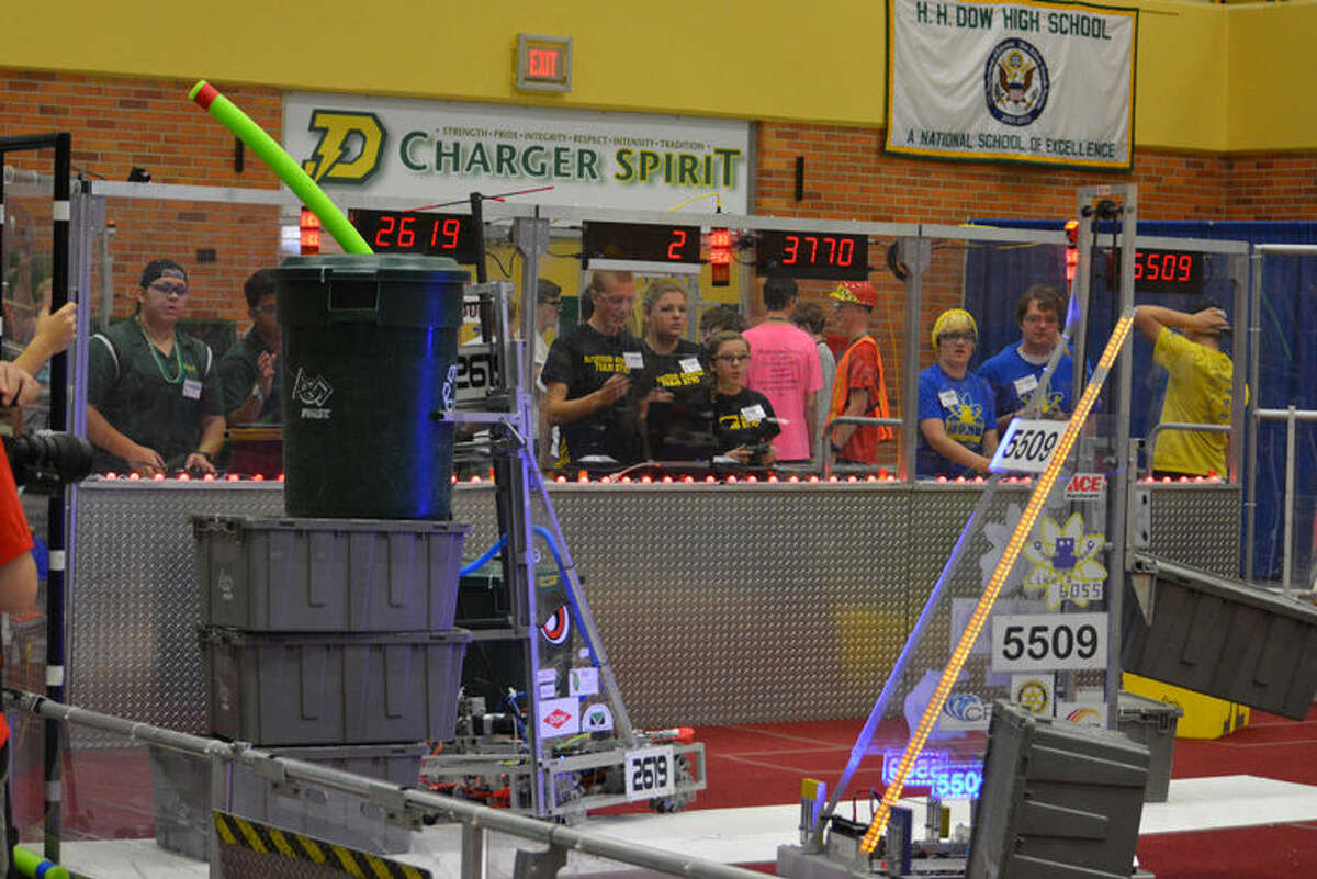 Robotics teams from H.H. Dow High School (The Charge, Team 2619) Bullock Creek High School (BlitzCreek, Team 3770) and Midland High School (Like A Boss, Team 5509) compete during a Bot Bash qualification match at Dow High.
