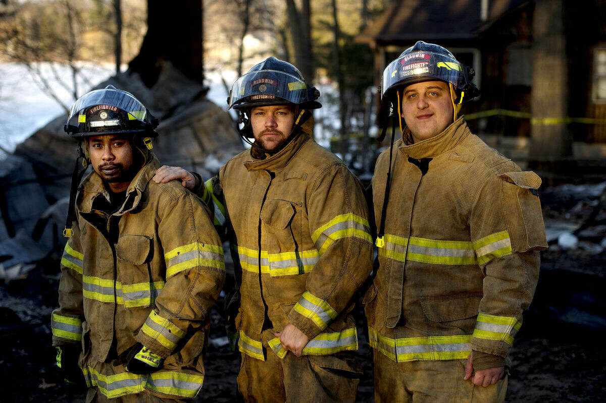 From left, Gladwin Rural-Urban Fire Department firefighters VJ Seng, Travis Povey and Dale Carper are shown at 1717 E. Pratt Lake Road, the scene of a fire where the three were were trapped for an hour under debris on Feb. 19.