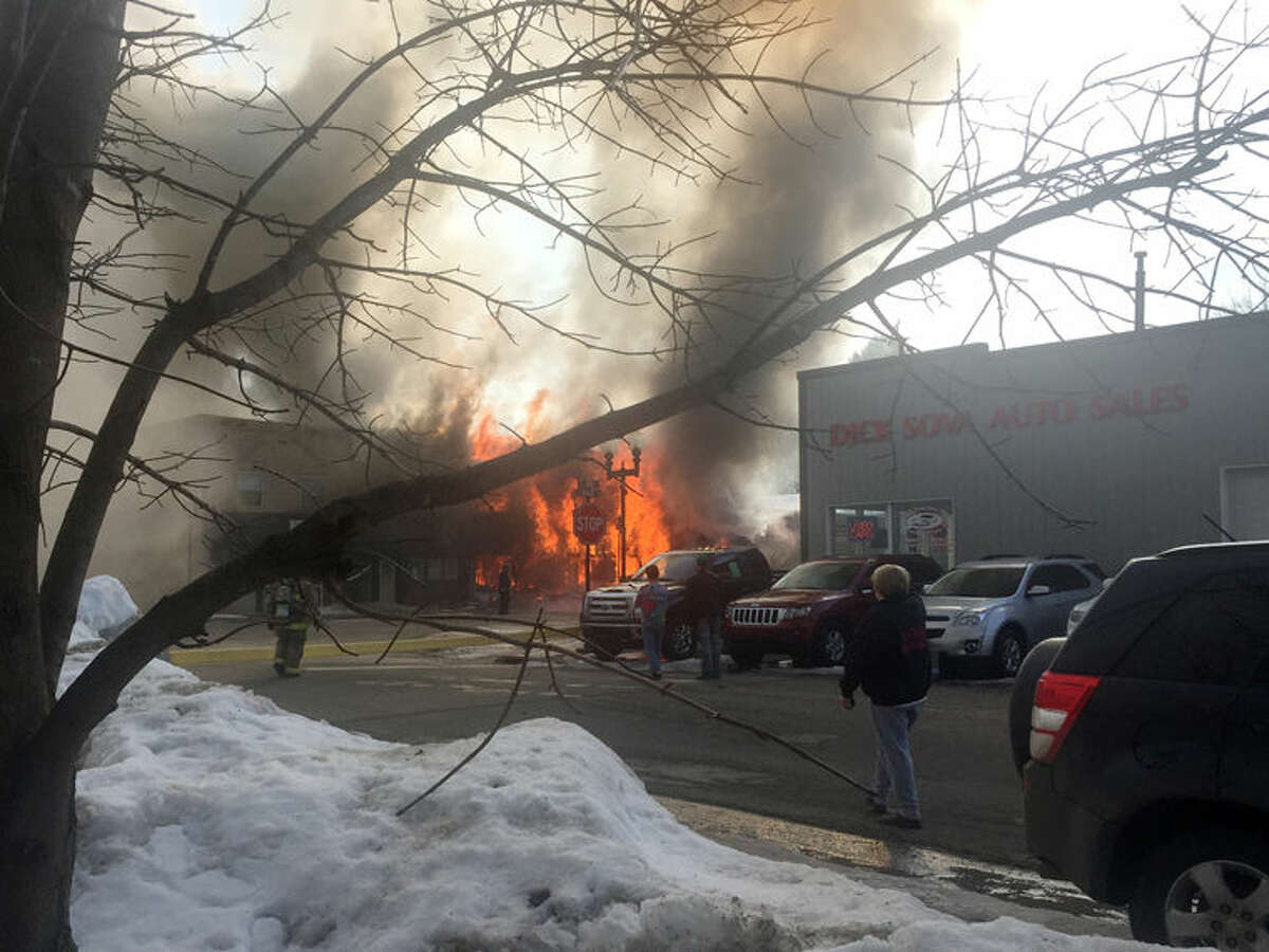 A fire in Shepherd destroys the Grim Printing Co., publishers of the Shepherd Argus newspaper, the Laundry Corner laundromat and a vacant storefront Tuesday afternoon.