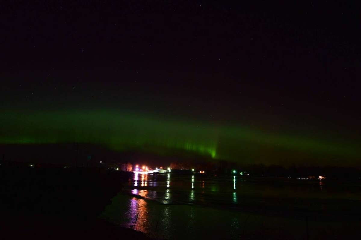 John Mccoy took this photo Tuesday night of the northern lights, looking north off the shore of Wixom Lake. The other lights are from Stryker's Lakeside Marina.