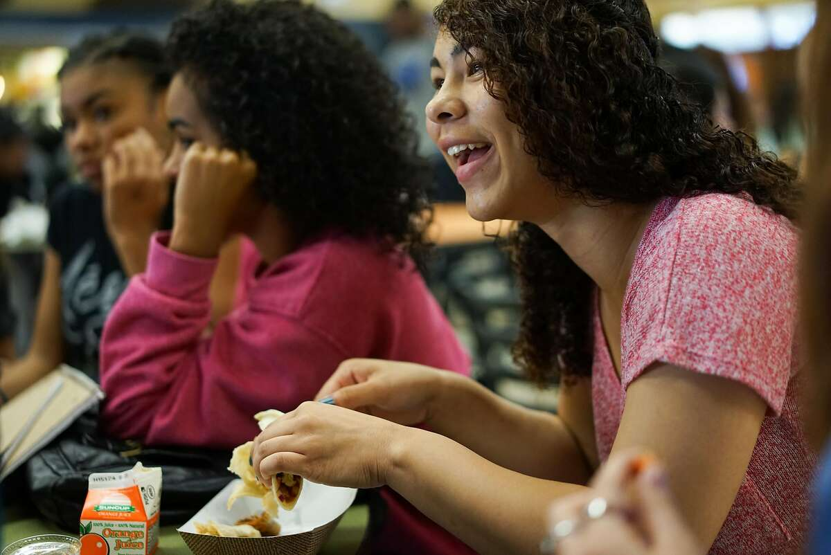 Junior Javonne Douglas laughs with her friends at Monterey High School in Monterey, Calif. on Tuesday, Aug. 25, 2015. Oakland Unified and Berkeley will be joining Bay2Tray which will send them underutilized fish such as Grenadier to use in their lunch programs.