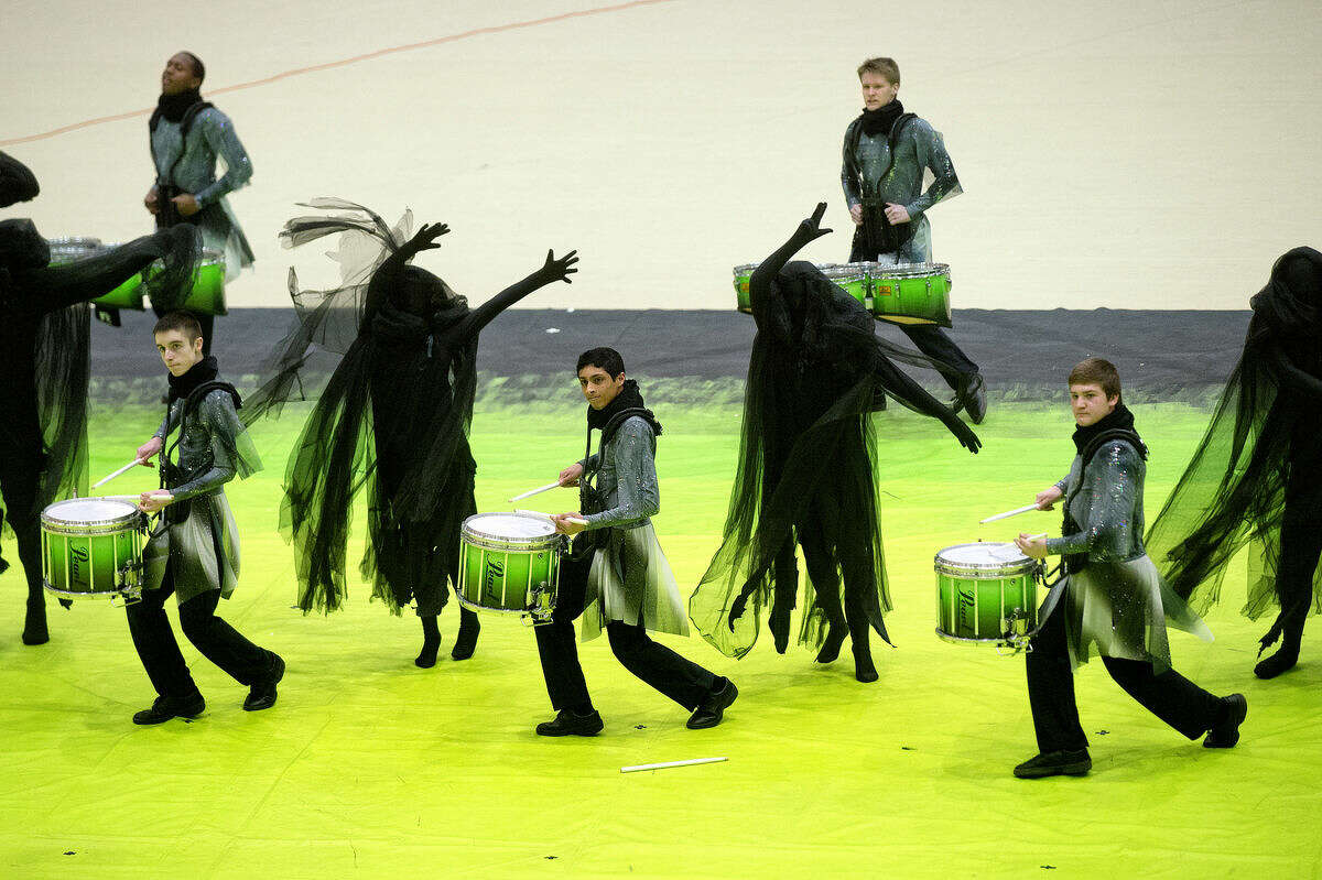 Members of the Novi Winter Percussion team perform their program 'The Entity' during the 40th Annual Michigan Color Guard Circuit Championships on Sunday at the SVSU Ryder Center. More than 100 Michigan and Canadian high school color guard and winds and percussion teams competed for judges and spectators over Saturday and Sunday event. Teams were judged based on criterion including, musicianship, execution, design, choreography and acrobatics, to name a few.during the 40th Annual Michigan Color Guard Circuit Championships on Sunday at the SVSU Ryder Center. More than 120 Michigan and Canadian high school color guard and winds and percussion teams competed for judges and spectators over Saturday and Sunday event. Teams were judged based on criterion including, musicianship, execution, design, choreography and acrobatics, to name a few.