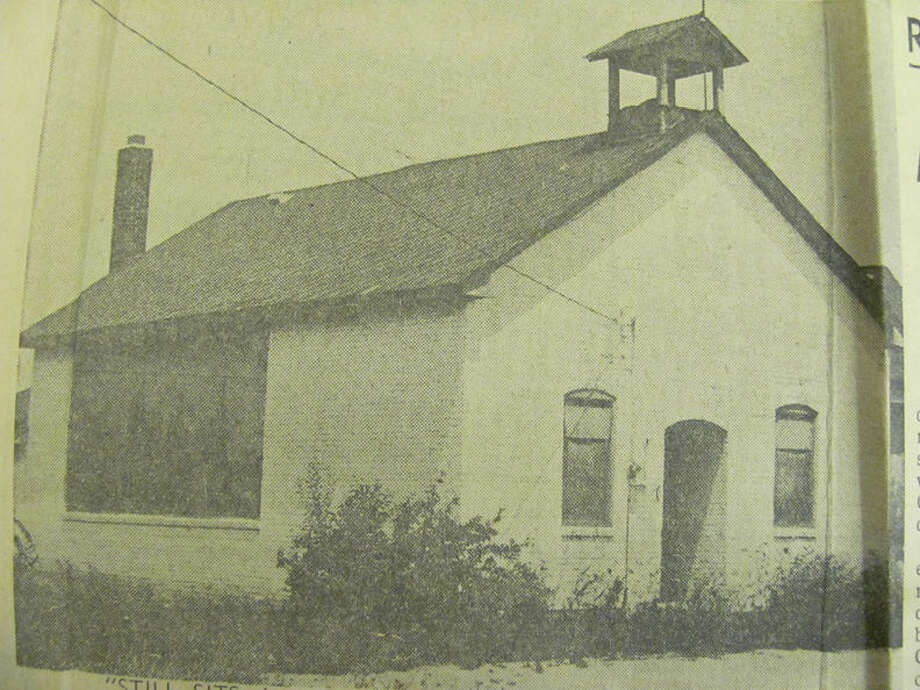 The old Poseyville School surrounded by weeds and memories. Photo from 1970.