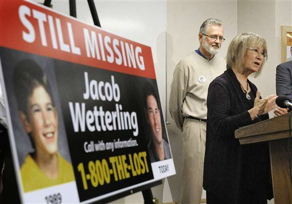 """FILE - In this Oct. 14, 2014 file photo, Patty, right, and Jerry Wetterling take part in a news conference at the Stearns County Law Enforcement Center in St. Cloud, Minn., to announce the installation of six new billboards that will be placed near where their son Jacob was abducted in 1989. Federal authorities said Thursday, Oct. 29, 2015, Daniel James Heinrich, a Minnesota man charged with child pornography after a search of his home found pictures of naked boys is also a """"person of interest"""" in the disappearance of Jacob Wetterling, whose 1989 abduction led his parents to launch a national center to prevent child exploitation. (Dave Schwarz/St. Cloud Times via AP, File) NO SALES; MANDATORY CREDIT"""