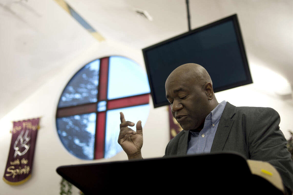 Faith Ministries Church Pastor Anthony Revis reads a passage from the Bible during the Wednesday evening Bible study.