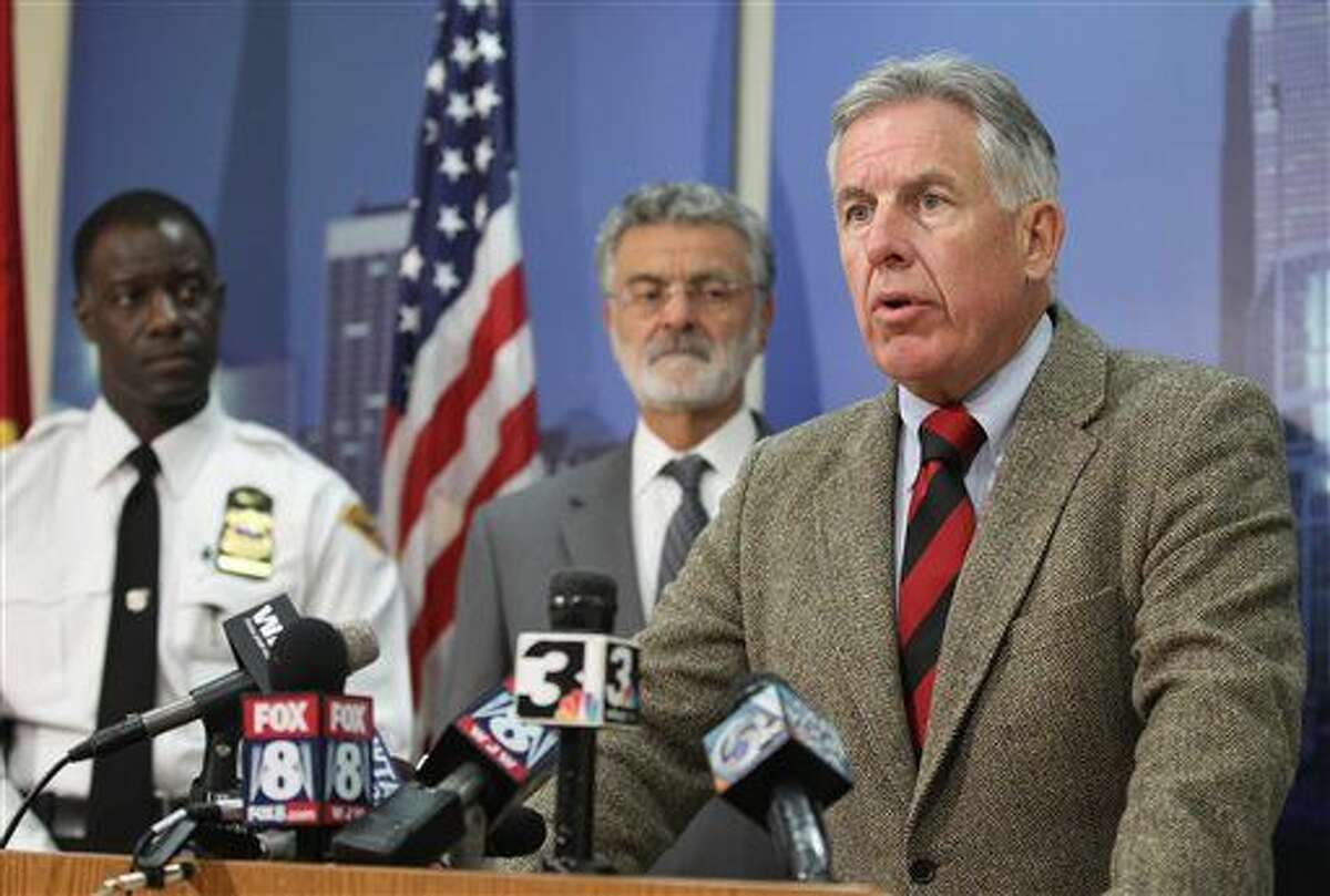 Cuyahoga County Prosecutor Timothy McGinty speaks during a news conference at police headquarters in Cleveland. A white Cleveland police officer was justified in fatally shooting a black 12-year-old boy holding a pellet gun moments after pulling up beside him, according to two outside reviews conducted at the request of the prosecutor. However, the Cleveland police union and the prosecutor still remain at odds despite the release of the reports.