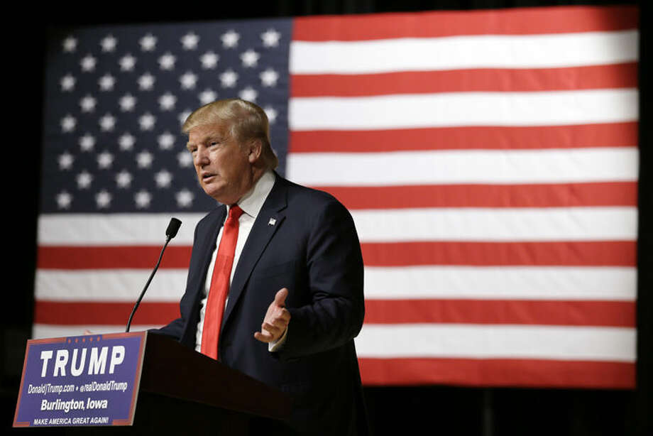 In this Oct. 21, 2015, photo, Republican presidential candidate Donald Trump speaks during a campaign stop at the Burlington Memorial Auditorium in Burlington, Iowa. Trump is getting ready to mount a major fight in Florida against two of the state's resident sons. Jeb Bush led Florida as a two-term governor and Marco Rubio has been a senator since 2011. (AP Photo/Charlie Neibergall) Photo: Charlie Neibergall