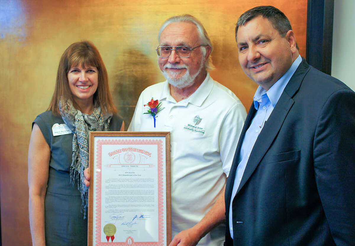 Jim Malek, center, is shown with MACF President and CEO Sharon Mortensen and Sen. Jim Stamas.