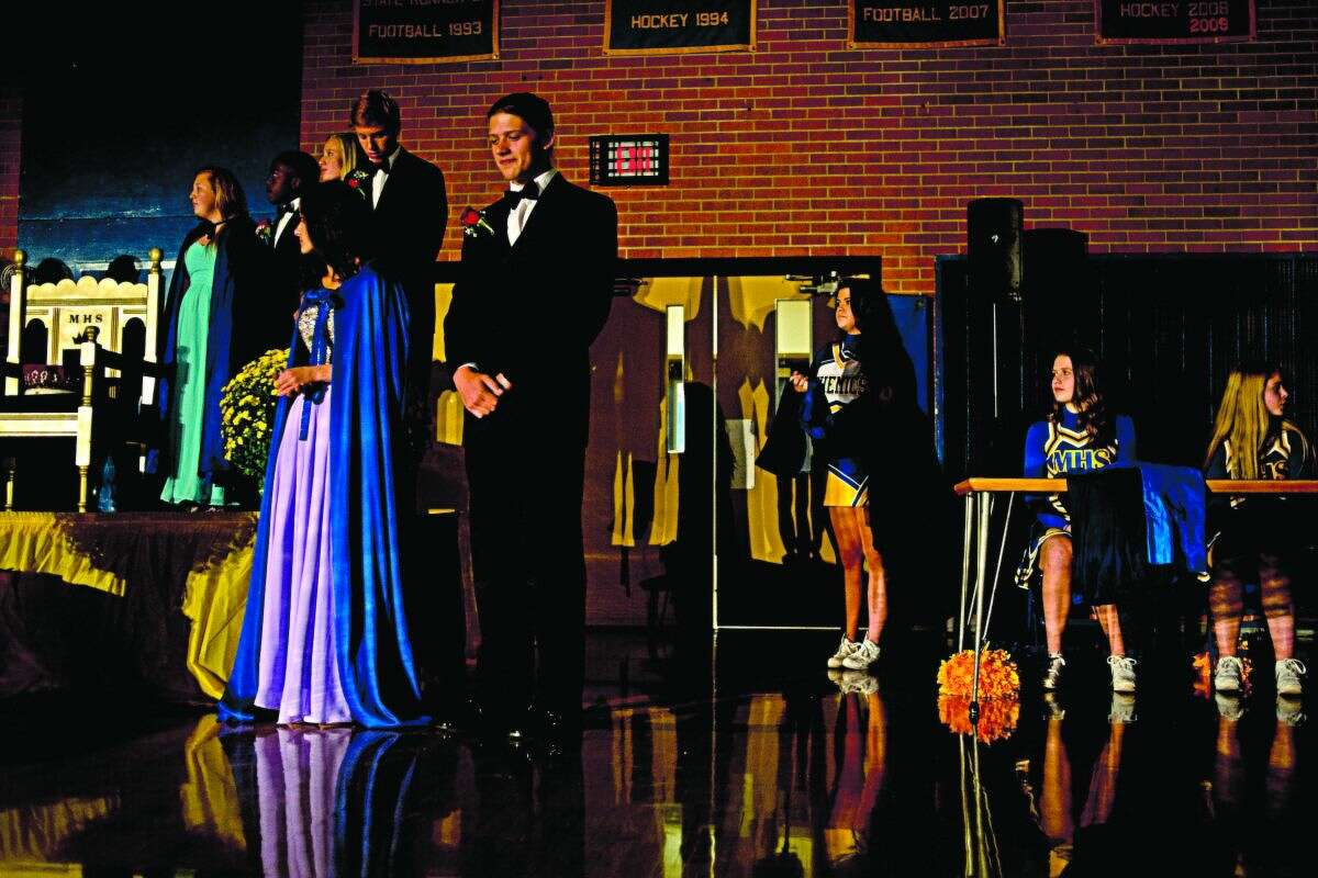 ERIN KIRKLAND   ekirkland@mdn.net Members of Midland royalty and the pom pom team listen as each candidate is introduced before the crowning of the Homecoming King and Queen on Friday at Midland High School. Seniors Hannah White, 17, and Jonathan Haynes, 17, were named queen and king.