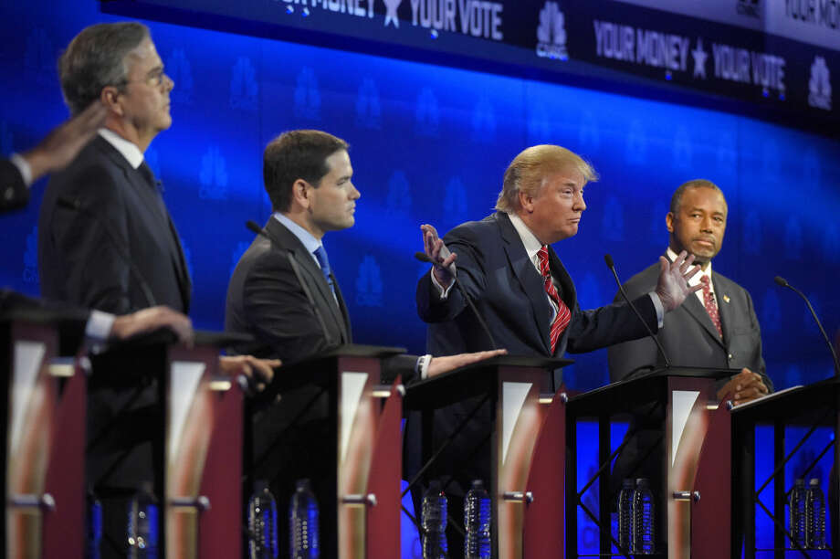 Donald Trump, second from right, speaks, as Jeb Bush, left, Marco Rubio, second from left, and Ben Carson look on during the CNBC Republican presidential debate at the University of Colorado, Wednesday, Oct. 28, 2015, in Boulder, Colo. (AP Photo/Mark J. Terrill) Photo: Mark J. Terrill