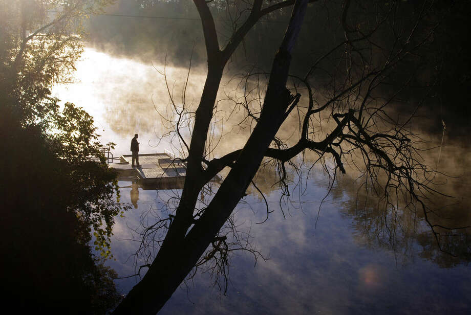 Fog rises over the Tittabawassee River near Midland's Tridge at approximately 7:50 a.m. Oct. 10. Photo: STUART FROHM For The Daily News