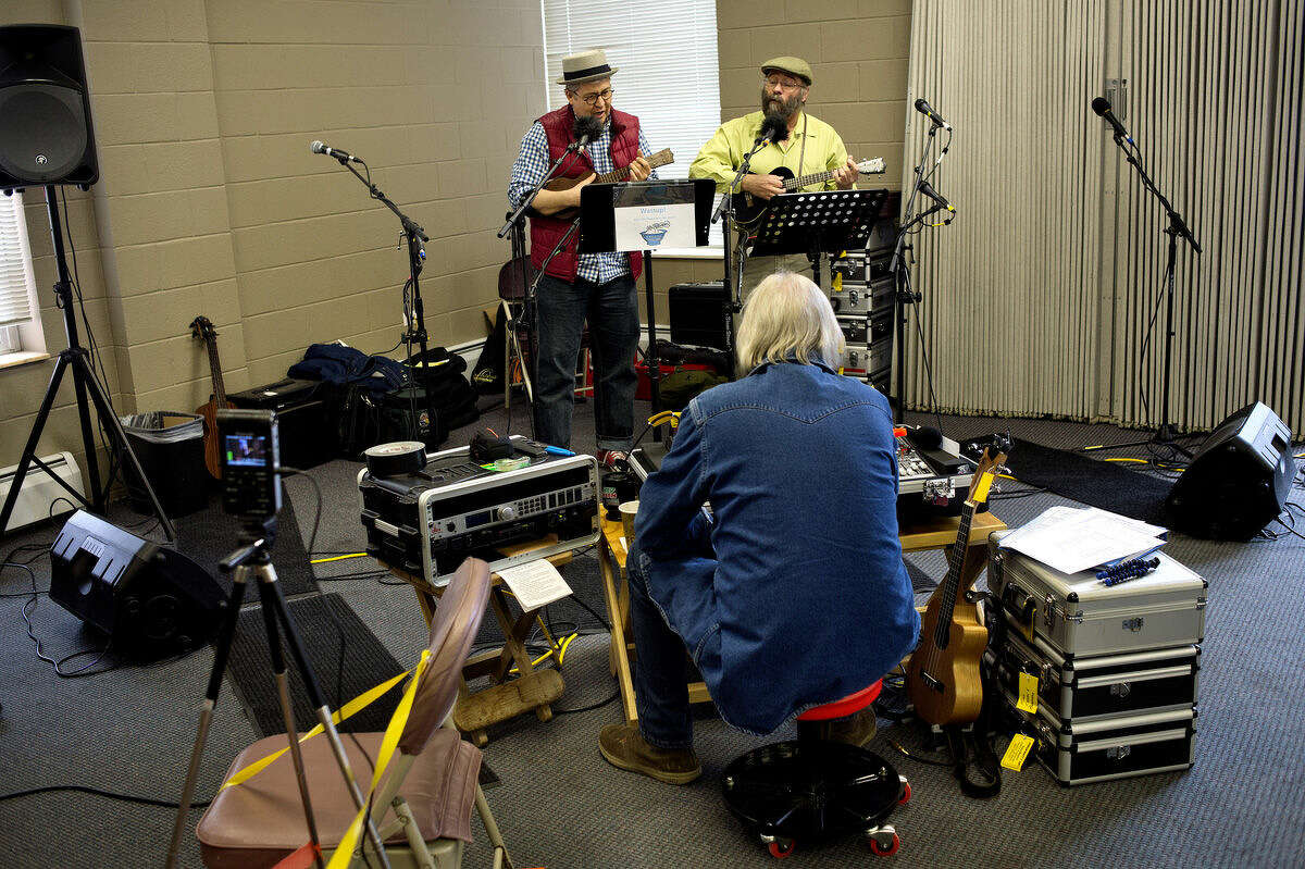 The duo Punch Drunk, John French, left, and Chuck Deyo, right, perform during an open-mic session at the Winter Ain't Stopping Serious Uke Players (WASSUP!) ukulele festival on Saturday at the Midland Free Methodist Church.