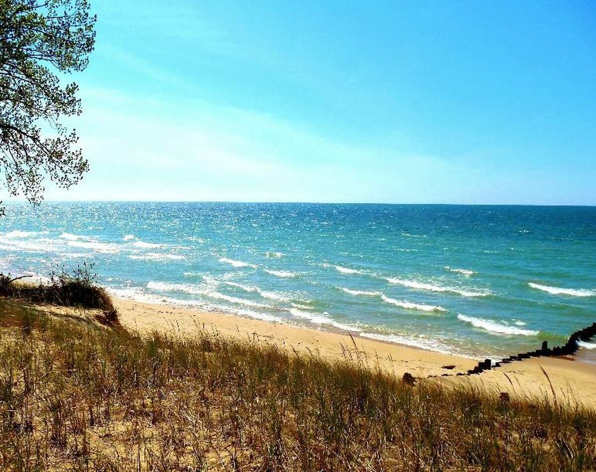 """Spring - Suellen Gause, Dowagiac, Mich.: Rocky Gap County Park in Benton Harbor, overlooking Lake Michigan. Gause took her photo on a spring day last May after shopping with a friend in Benton Harbor. """"It was one of those days when the sun was bright, the sky was blue and the lake was gorgeous,"""" Gause said. """"The power and majesty of 'the big lake' fascinates me, yet I always find a sense of tranquility and peace there."""""""
