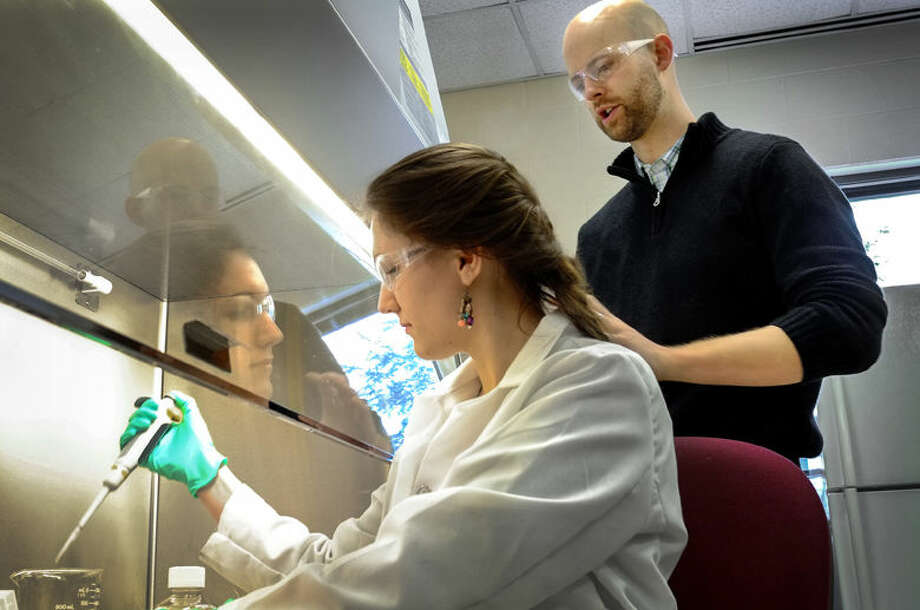 Chemistry professor Ben Swarts and his undergraduate student Bailey Urbanek Photo: Steve Jessmore